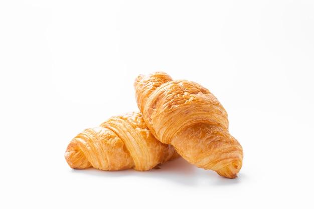 Fresh croissants on white surface.
