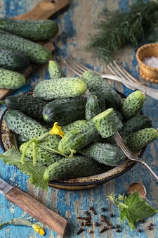 Fresh cucumbers in a bowl on vintage  table