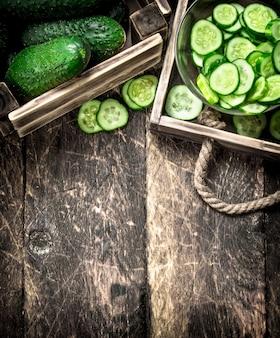 Fresh cucumbers in an old box