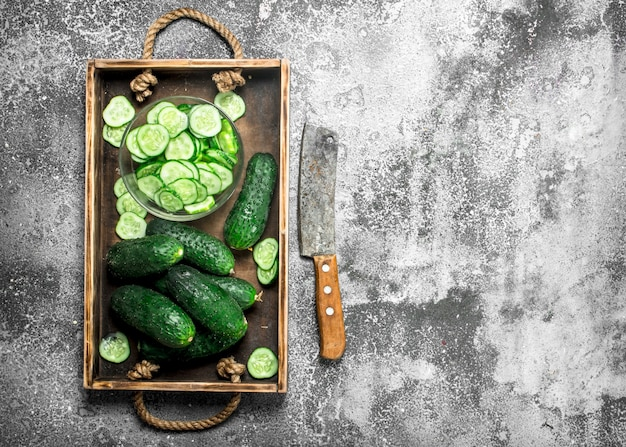 Fresh cucumbers in an old tray