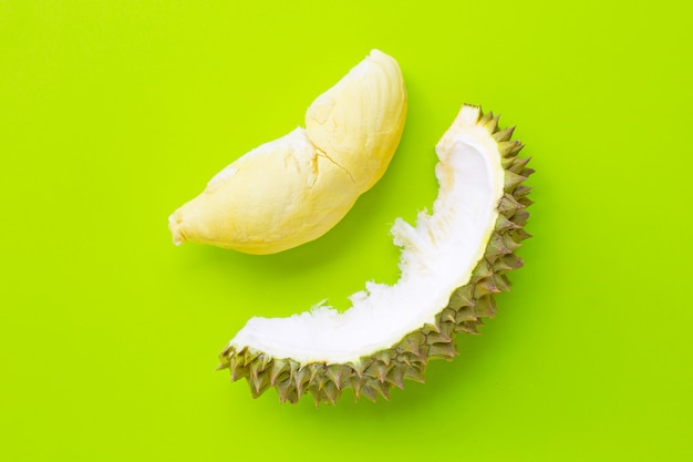 Fresh cut durian on green background.