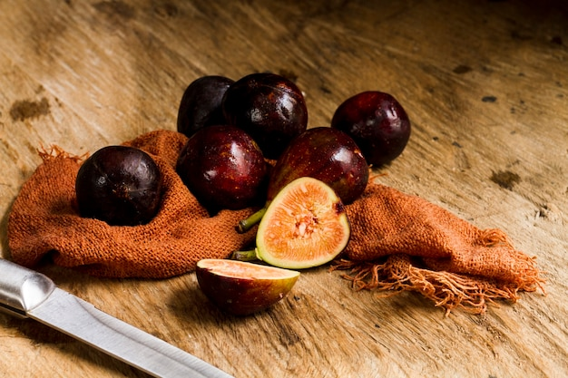 Fresh cut figs on wooden table