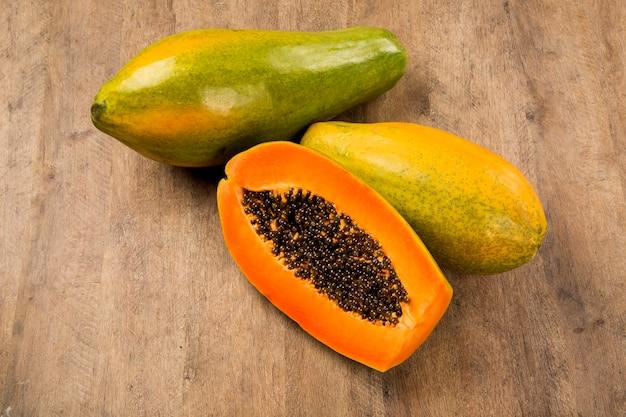 Fresh cut juicy tropical papaya mamao fruit with seeds at brazilian. fresh fruits