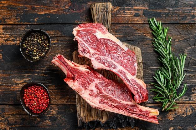 Fresh cuts of raw beef meat on a cutting board