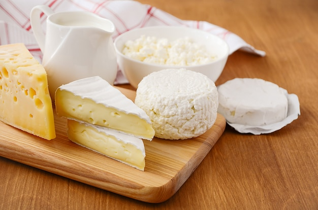 Fresh dairy products. milk, cheese, brie, camembert and cottage cheese
