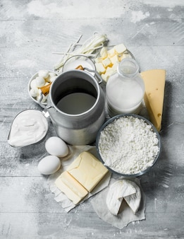 Fresh dairy products . on a rustic table.