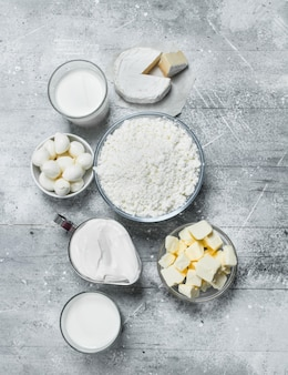 Fresh dairy products on rustic table.