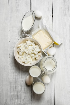 Fresh dairy products on white wooden background
