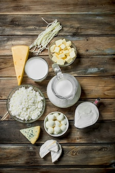 Fresh dairy products on a wooden table.