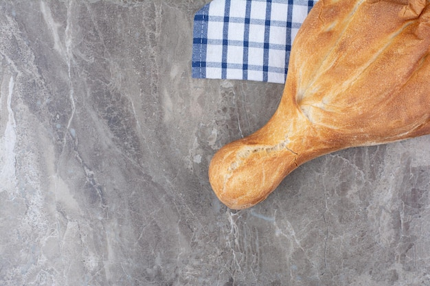Fresh delicious bread lying on tablecloth. high quality photo