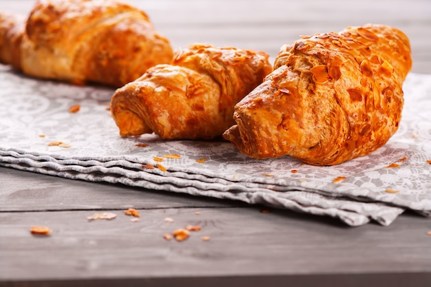 Fresh delicious crunch croissants with almond and marzipan filling