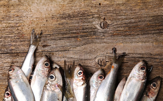 Fresh delicious fish on wooden table