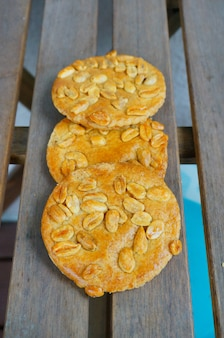 Fresh delicious golden peanut cookies placed on wooden planks