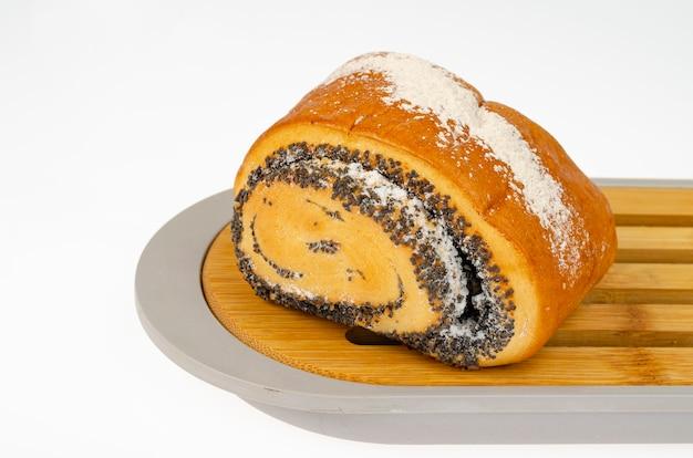 Fresh delicious homemade pastries, poppy seed bun. studio photo.
