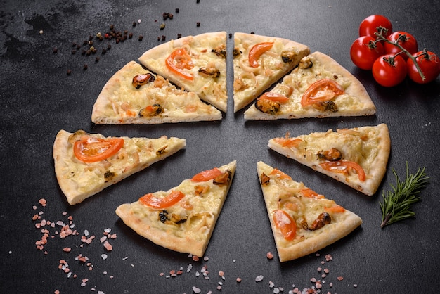 Fresh delicious pizza made in a hearth oven with shrimp mussels and other seafood. mediterranean cuisine