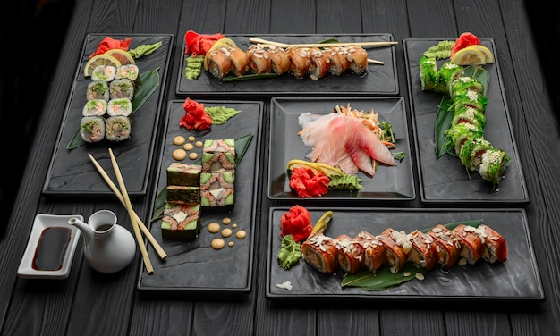 Fresh and delicious sushi set on black surface. japanese food