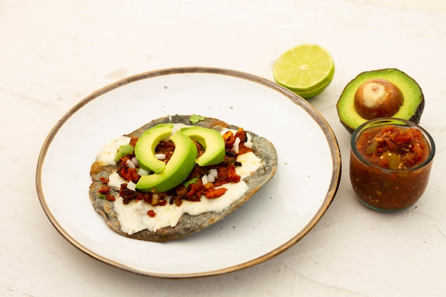 Fresh dish with avocado and seeds