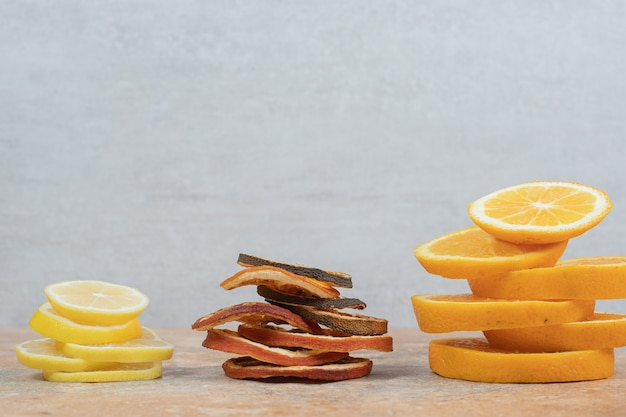Fresh and dried lemon and orange slices on marble table. high quality photo