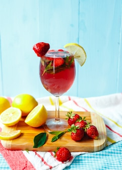 Fresh drink of strawberry summer and lemon and strawberry fruits.