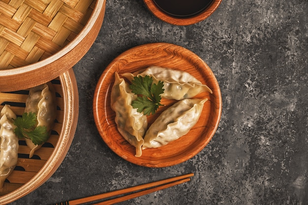 Fresh dumplings on a dark stone background