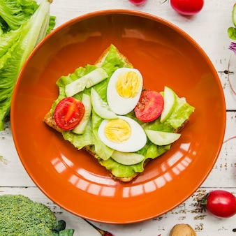 Fresh egg and vegetables sandwich in bowl
