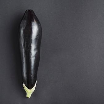 Fresh eggplant on gray background
