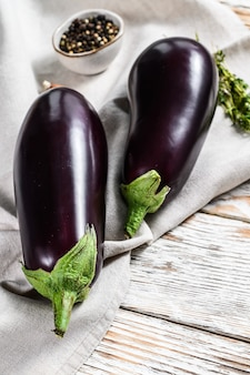 Fresh eggplant. raw organic vegetables. white background. top view.
