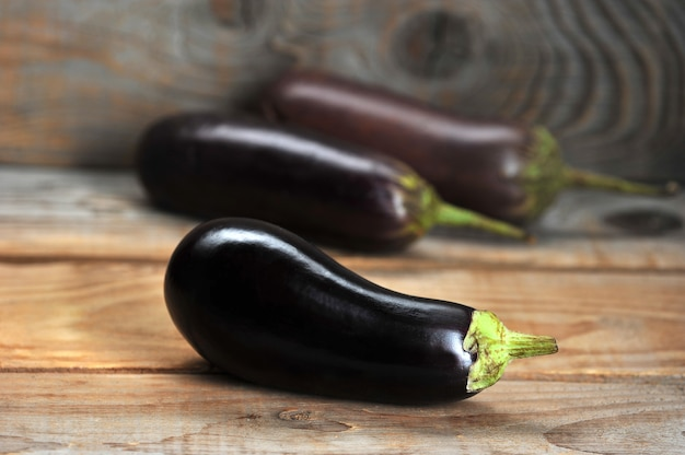 Fresh eggplant on rustic background