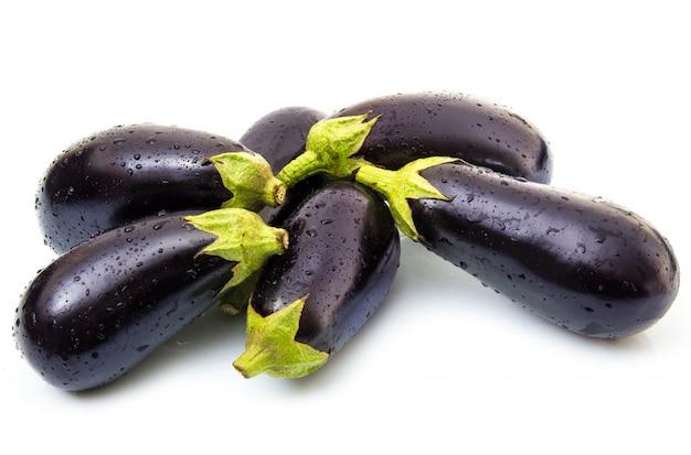 Fresh eggplant on white