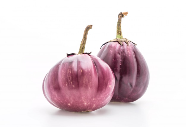 Fresh eggplant on white