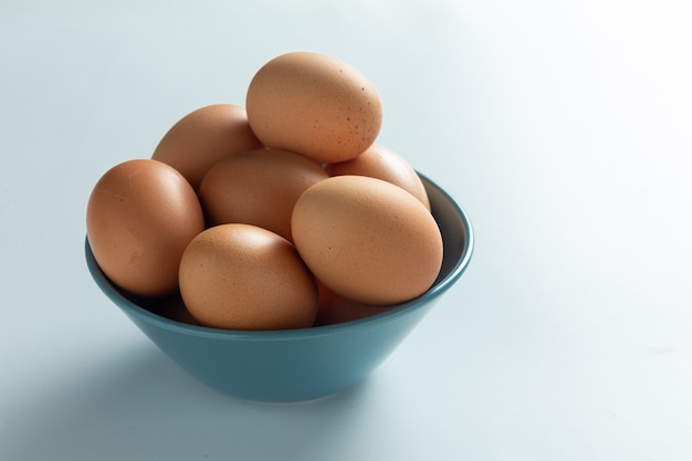 Fresh eggs in bowl.