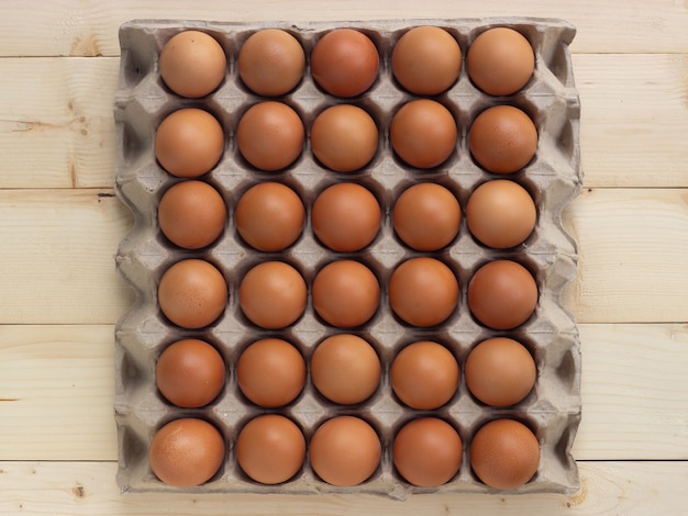 Fresh eggs on paper egg box. food ingredient for hight protein.