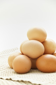 Fresh eggs on white background with copy space