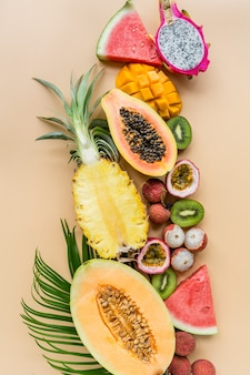 Fresh exotic fruits on orange background