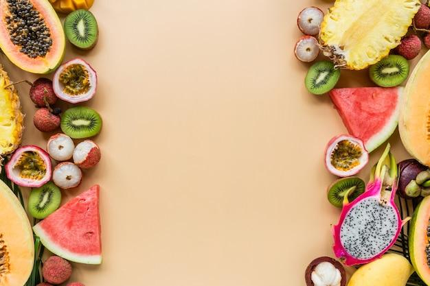 Fresh exotic fruits on pastel orange background