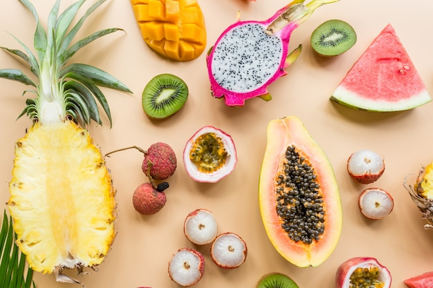 Fresh exotic fruits on pastel orange