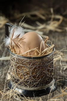 Fresh farm eggs. easter egg with feather concept