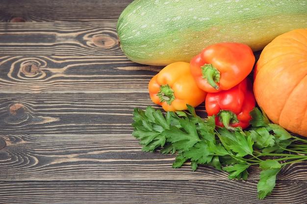 Fresh farmers garden vegetables on wooden table