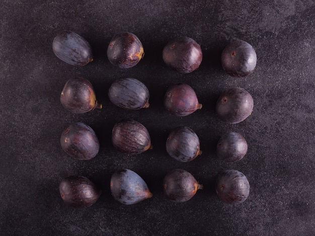 Fresh figs on a dark wood, top view
