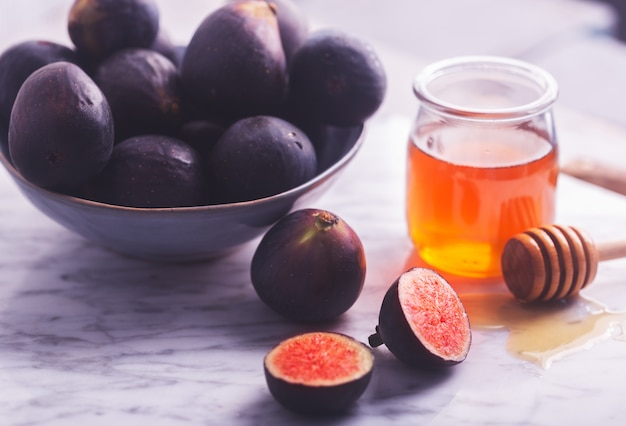 Fresh figs on a white stone with honey