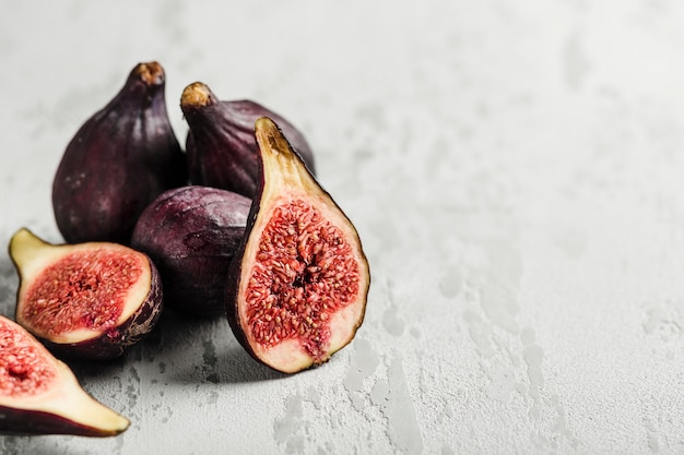 Fresh figs whole and cut into slices on light close-up