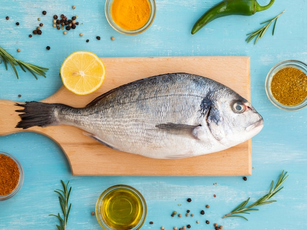 Fresh fish laying on a wooden board