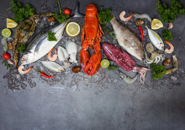 Fresh fish and seafood on dark surface