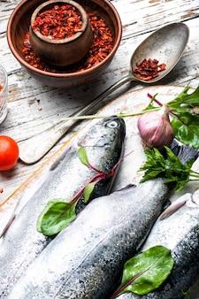 Fresh fish on wooden background