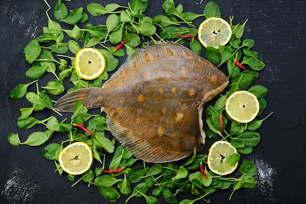 Fresh flounder without head on wooden