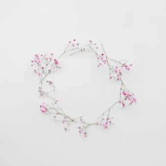 Fresh flower twigs composed in circle