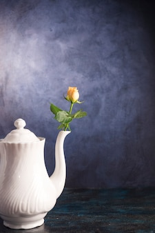 Fresh flower in vintage teapot
