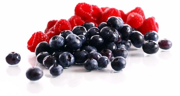 Fresh forest berries over white