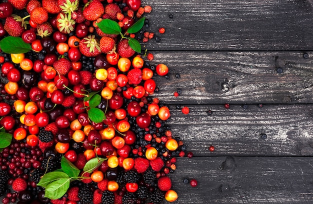 Fresh forest berries on wooden background
