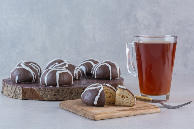 Fresh fragrant tea with chocolate cookies on wooden board